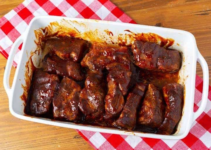 Oven Baked Country Style Ribs in a white baking dish