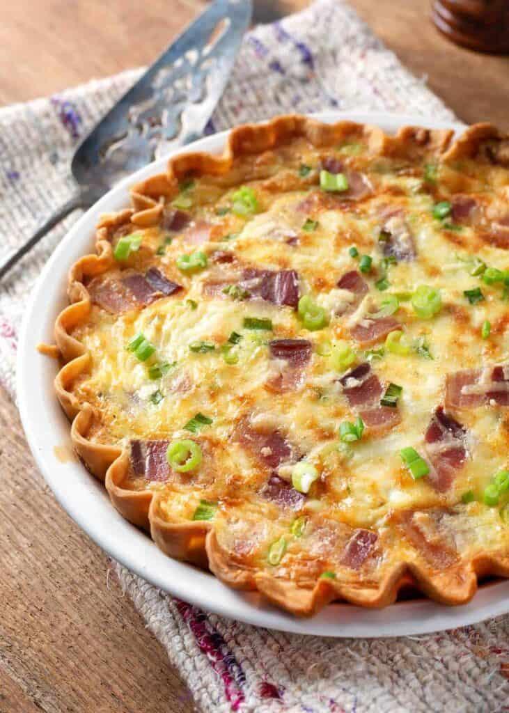 Quiche in a white pie plate