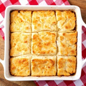 cut biscuits in a white baking dish