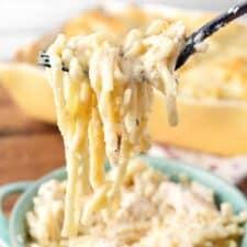 Fettuccine Alfredo Casserole bite hanging from a fork