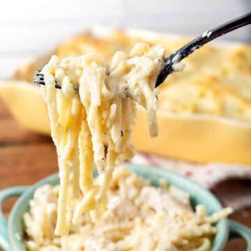 Chicken Fettuccine Alfredo Casserole bite on a fork