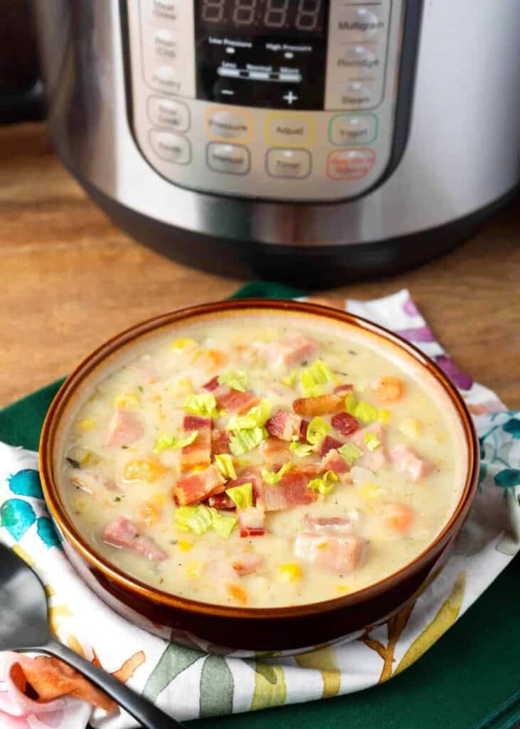 pressure cooker Potato Ham Chowder in a brown bowl