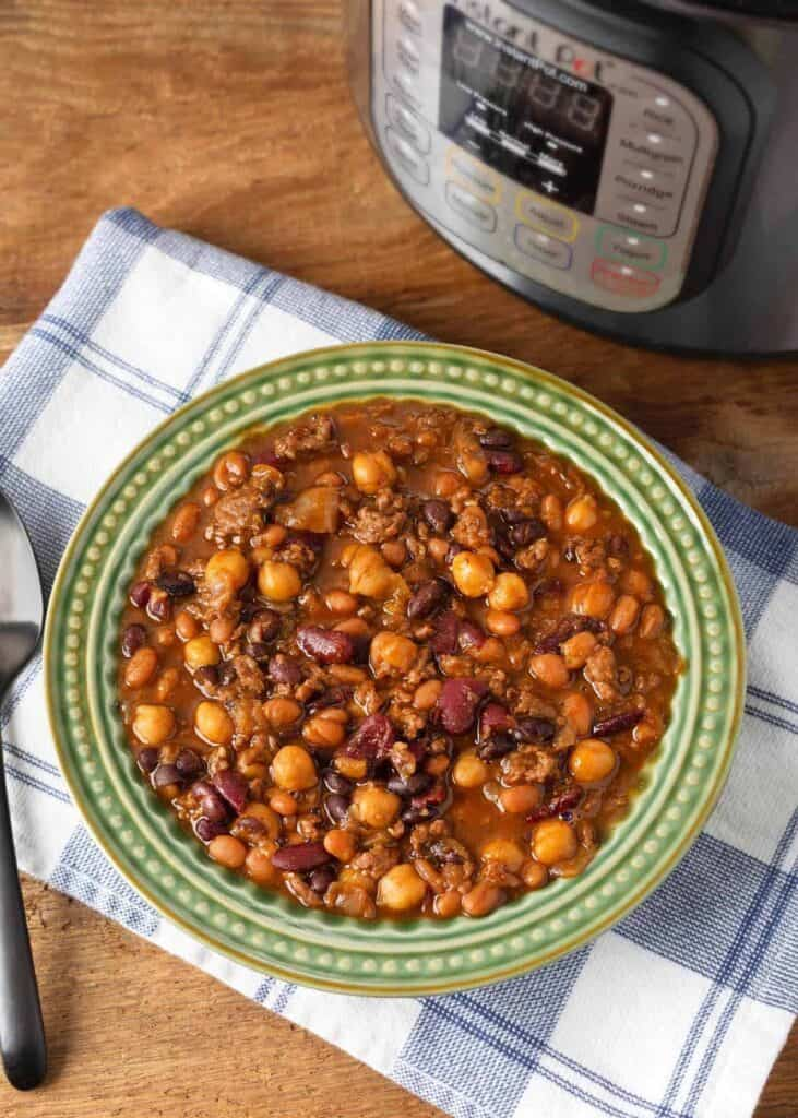 Instant Pot Hamburger Baked Beans in a green bowl