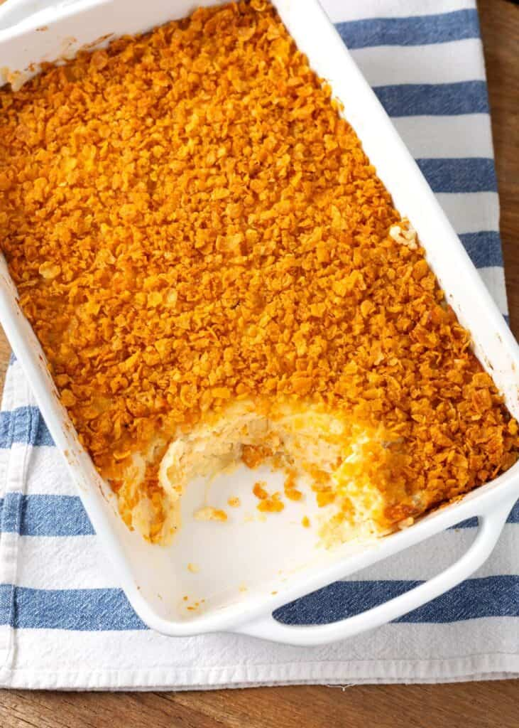 Funeral Potatoes in a white baking dish