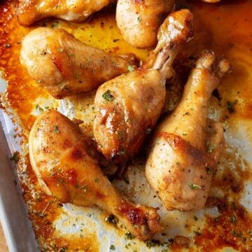 Chicken Drumsticks on a baking sheet close up