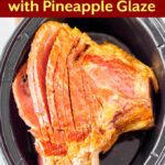 pinterest pin for Slow Cooker Spiral Ham with Pineapple Glaze, looking down on crock with ham in it