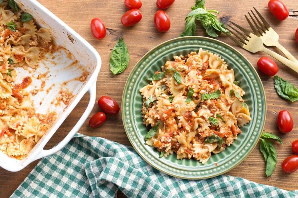 Baked Tomato Feta Pasta in a green bowl seen from above