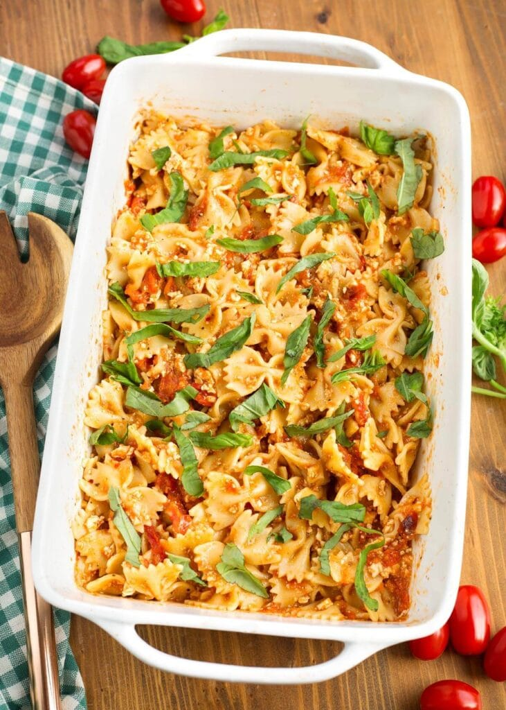Baked Tomato Feta Pasta in a white baking dish seen from above