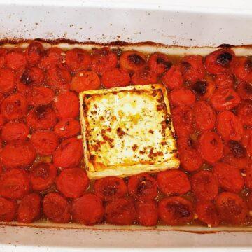 Baked Tomato Feta Pasta in a white baking dish