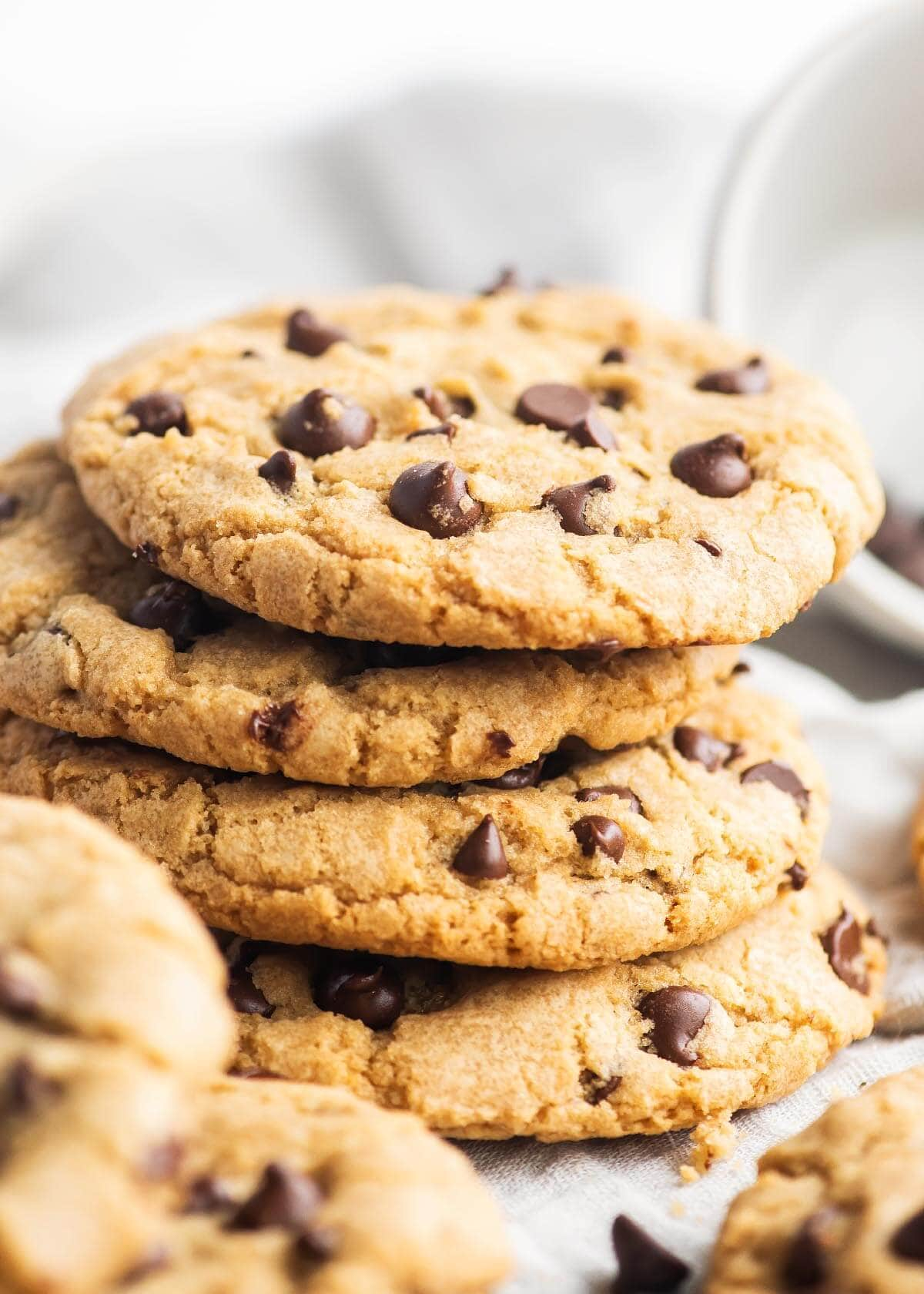 Chocolate Chip Cookies in a stack on a white cloth