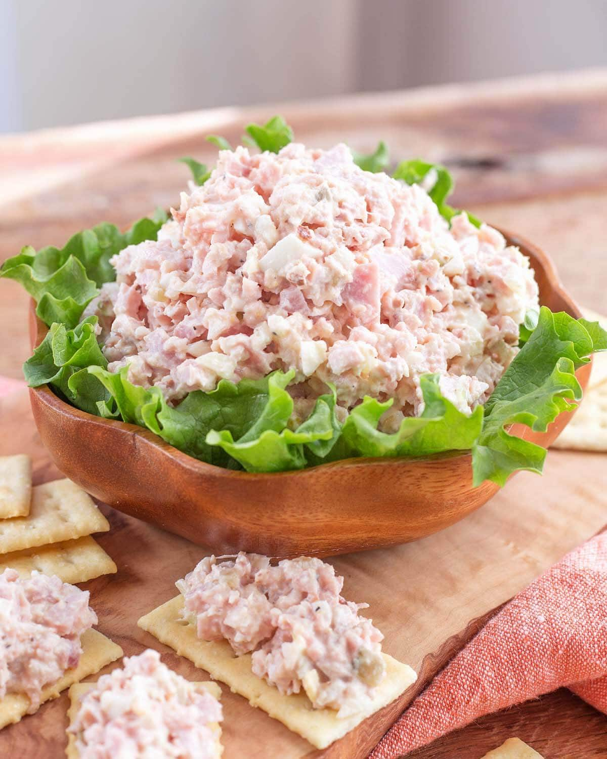 Classic Ham Salad in a wood bowl on lettuce leaves