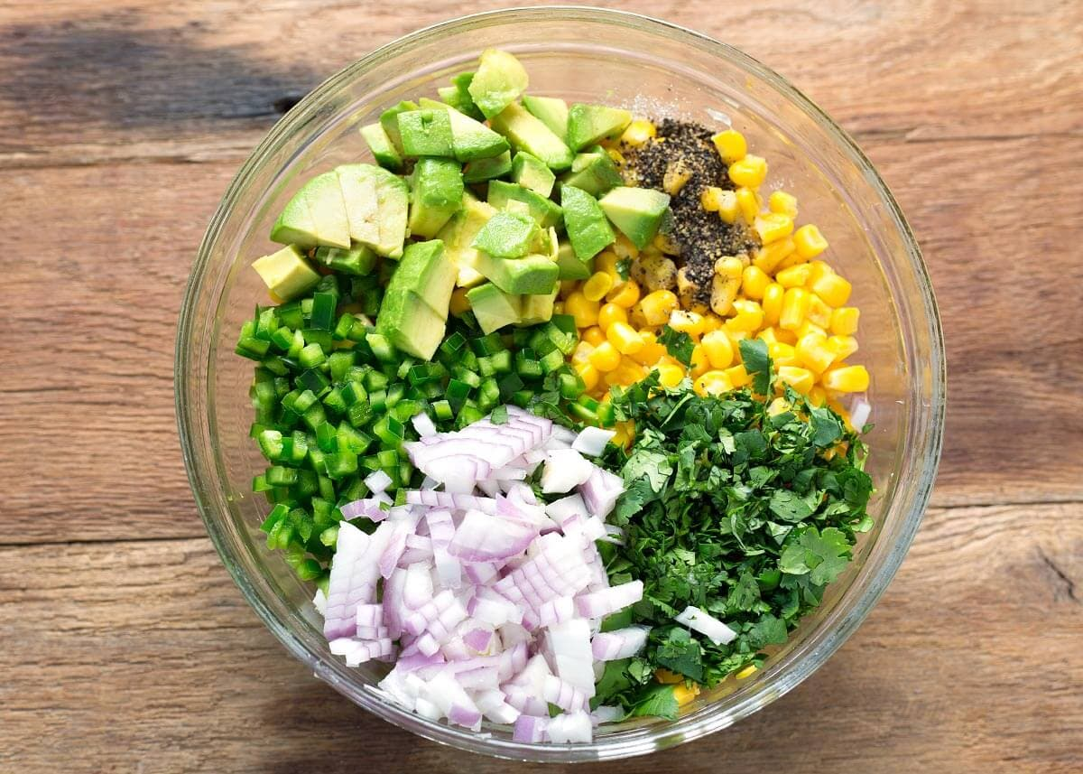 Easy Corn Salsa ingredients in a bowl from above