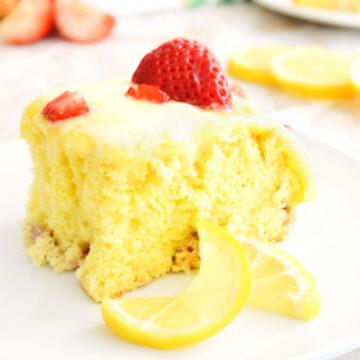 Lemon Strawberry Poke Cake slice on a white plate