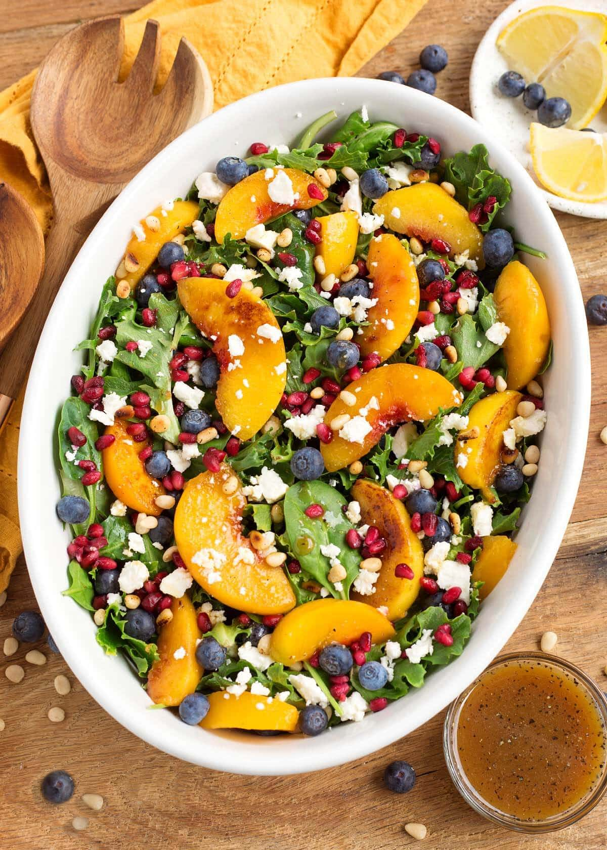 Peach Salad with Blueberries and Feta in a white oval dish from above