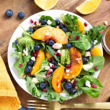 Peach Salad with Blueberries and Feta on a white plate from above