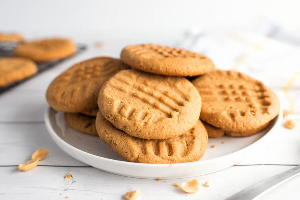 Peanut Butter Cookies piled on a white plate