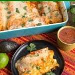 Beef and Bean Burritos in a baking dish and one on a black plate