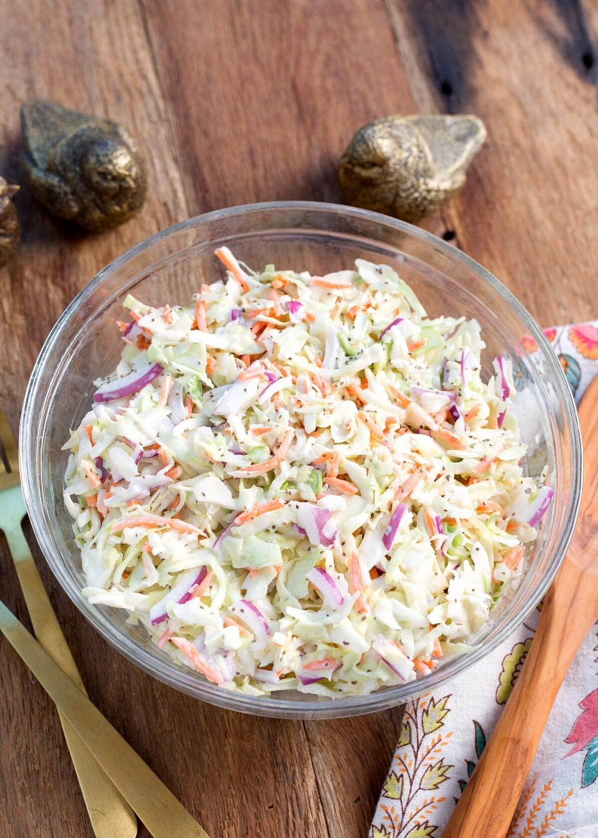 Easy Coleslaw Recipe in a glass bowl on a wood background