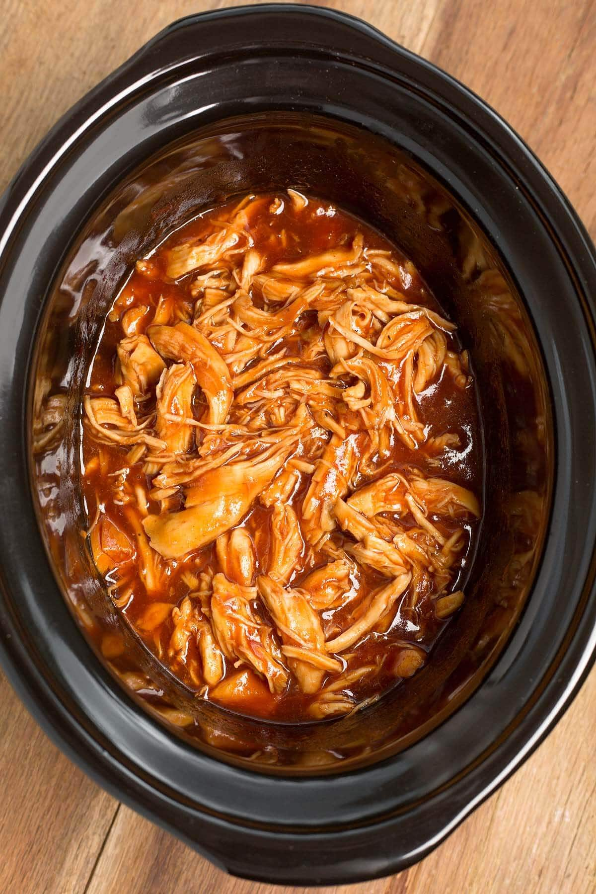 BBQ Pulled Chicken in a black crock from above