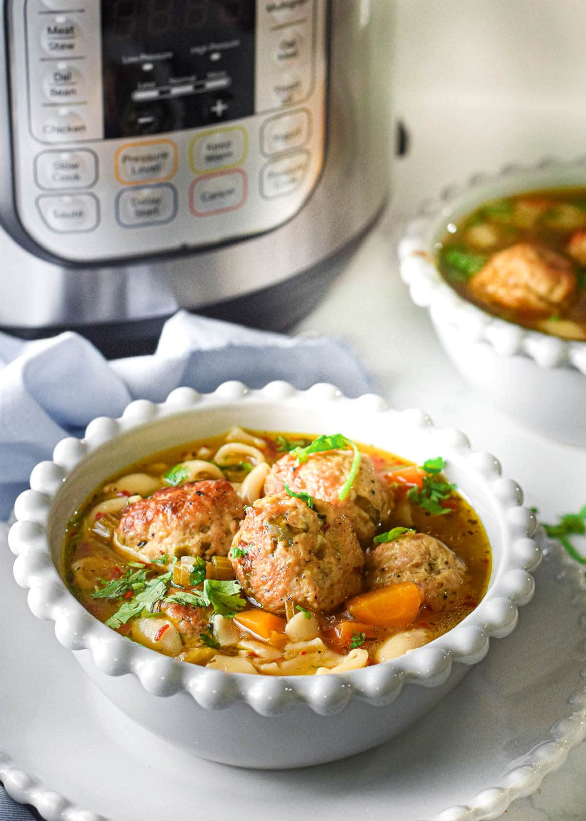 Meatball Pasta Soup in a white bowl