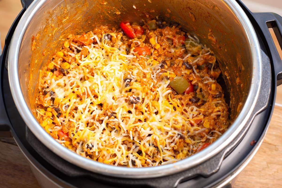Cooked Enchilada Rice with cheese on it in pot