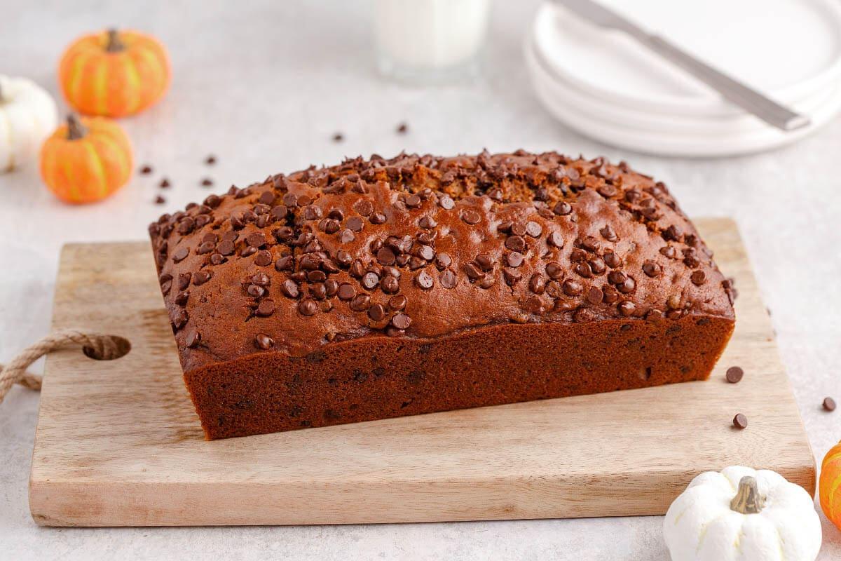 loaf of pumpkin bread on cutting board