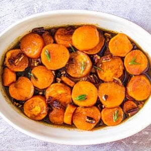 Maple Candied Sweet Potatoes in a white casserole dish